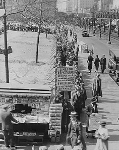 People stand in line for bread during the Great Depression, NYC, 1930s.
