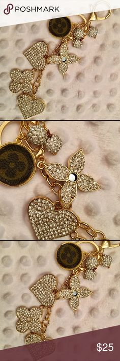 NEW 💋 Rhinestone Clover & ❤️ Keychain/Bag Charm! NWOT Glitzy & Glam Rhinestone-studded Clover & ❤️ Keychain/Bag Charm!  Black enamel on the charm backs! Made with Gold Tone Lobster Claw & Jump Ring. All the keychains I'm offering are great quality & have been embellished with handmade rhinestone baubles. The round charm is made from genuine material, creating a gorgeous one-of-a-kind purse accessory! From non-smoking home. Accessories Key & Card Holders