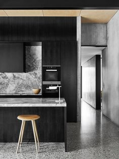 """Adding texture and tone through deeply veined marble brings sophistication to a monochrome kitchen. [Take the tour](http://www.homestolove.com.au/level-best-2642/?utm_campaign=supplier/ target=""""_blank""""). Photo: Brooke Holm   *Belle*: [object Object]"""