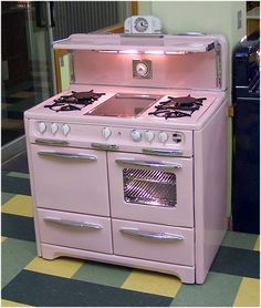 1951 restored pink wedgewood stove. A MUST in my future pink mint kitchen.