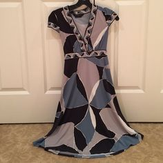 BCBG MAXAZRIA- printed dress Adorable BCBG dress in a blue, grey, black pattern. Has a V- neckline, cap short sleeves, and ties in the back. Barely worn, like new condition.  This is an XS Petite BCBGMaxAzria Dresses