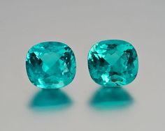 Bonded: Paraiba tourmaline from Mozambique; right, 6.0 carats, 11.35 x 10.71 x 7.47 mm.; left, 5.53 carats, 11.23 x 10.81 x 7.04 mm. (Photo: Mia Dixon