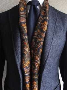 Love the Navy blue with the paisley scarf. All men should wear scarfs
