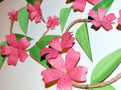 This hot pink floral vine is made from handprinted papers. The flowers are adorned with golden spots. They bloom from a vine covered in leaves. The vine is a hand made branch with a steel inner, which makes this wall hanging robust and sturdy. It can hang from a hook or nail in any direction.  This would make a lovely new home gift and would bring some springtime cheer to any decor.  Measurements: 42 x 32 x 5cm.  This floral vine is one of a kind. I have others in the Flowers & Butterflie...