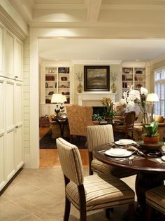Transitional Dining and Living Room with Coffered Ceilings and Rich Accents