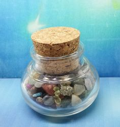 Glass Jar filled with semi precious stones size of 6x5cm  total weight 122 grams