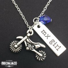 """Are you a Motocross girl? Then this necklace is perfect for you! Comes in a beautiful custom box to keep it safe. The necklace is plated in silver, so it won't tarnish or fade! The chain is 18"""" in len"""