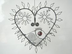 Wire Heart Sculpture With Leaves And Flowers And A by MyWireArt