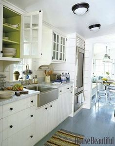 Painting exposed shelves is such an easy way to incorporate color into a neutral kitchen.    Source: Don Freeman for House Beautiful