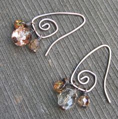 These are a little different than the ones I make now, from silver and brass. Cute variation.