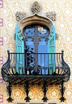 Classical Barcelona exterior. Love the colorful patterns and rod iron balcony!