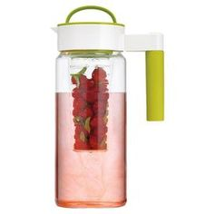 Complete with interchangeable inserts, this versatile pitcher is perfect for infusing drinks with fresh flavors or keeping your beverages cool on the go.  Product: PitcherConstruction Material: Glass and plasticColor: Green and clearFeatures: 1.65 Liter capacityAir tight lidFruit infuserIce chillerTea brewing filter