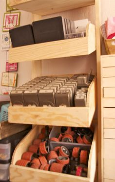 I like the punch storage here. This would look nice inside an ikea expedit square shelf unit.