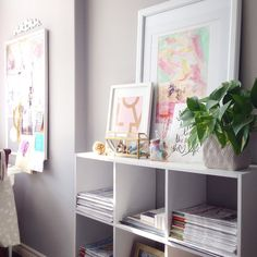 Elliven Studio workspace.  Open shelving to hold magazines, inspiration board and children's art.