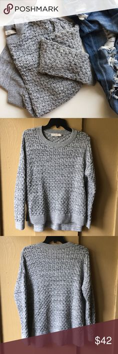 "LOFT open knit chunky sweater Loft open knit chunky sweater. Size. XL. Gently used condition. Very minimal signs of wear. Side split high-low hem. Marled knit composed of 81% cotton, 19% polyester. Appears gray in color and has black flecks. Armpit to armpit measures approx 22"". Back length approx 27"". Front length approx 21"". Hip measures approx 20.5"" across. This runs a bit small in my opinion. PLEASE REFERENCE MEASUREMENTS FOR PROPER FIT. Perfect for fall! LOFT Sweaters Crew & Scoop Necks"