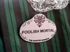 I made this cast member name tag of wood & decopaged the foolish mortal printed paper over it! perfect for my Haunted mansion maid costume!