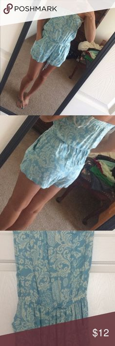 Blue paisley type romper! Blue romper with cute print. Has pockets. Is strapless. Worn once. Francesca's Collections Dresses