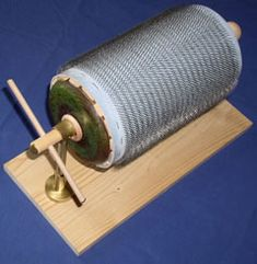 DIY tool for fiber artists: Minimalist Drum Carder, from SpinningForth.com. Far less expensive than a commercially-made drum carder and more efficient than hand carding, if less so than the commercial models. Also, a possible intermediate step if you're considering buying a drum carder, but aren't sure if it's worth the investment for you yet.