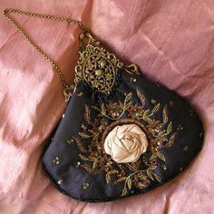 Evening bag with silk rose, from Lily Rose and Wylde.