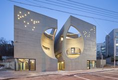 Crescent-shaped cutouts give Moon Hoon's Two Moon building its playful edge