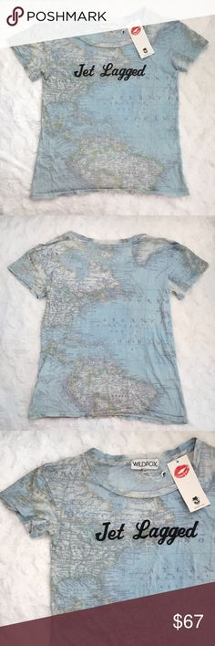 Wildfox Jet Lagged Tee No matter your destination, tour around the world in style with Wildfox's map print tee, flaunting a first-class cheeky graphic that jet setters can relate to. Round neck, short sleeves, screen printed text, map print graphic. Wildfox Tops Tees - Short Sleeve