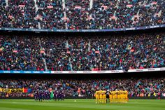 FC Barcelona and Atletico de Madrid players observe a minute of silence in memory of former player Enrique Castro 'Quini' before the La Liga match between Barcelona and Atletico Madrid at Camp Nou on March 4, 2018 in Barcelona.