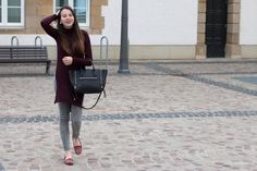 Shop this look on Lookastic:  https://lookastic.com/women/looks/burgundy-sweater-dress-grey-skinny-jeans-burgundy-loafers/14318  — Grey Skinny Jeans  — Black Leather Tote Bag  — Burgundy Sweater Dress  — Burgundy Suede Loafers