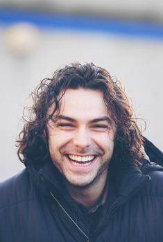 Aidan Turner such a wonderful smile.