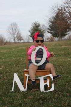 First birthday picture idea!Little girl a lot of style.