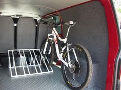 Diy Bike Rack, Bicycle Rack, Van Conversion Interior, Van Interior, Vw Transporter Camper, Vw T5, Garage Apartment Floor Plans, Garage Apartments, Bike Storage In Van