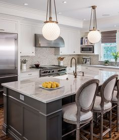 This kitchen island is nearly 10' and features Calacatta quartzite countertop. Find out more new interior design ideas!  (scheduled via http://www.tailwindapp.com?utm_source=pinterest&utm_medium=twpin&utm_content=post113433277&utm_campaign=scheduler_attribution)