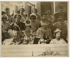 Queen Mary with lorgnette, Princess Elizabeth of York, Princess Margaret Rose of York and her aunt Princess Royal Mary, Behind her Princess Alice of Athlone and her husband the Earl of Athlone during the coronation of Elizabeth and George in 1937.