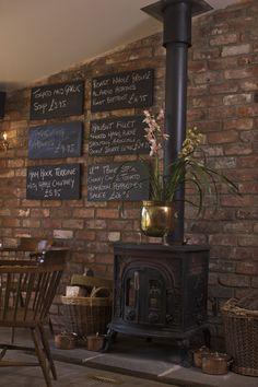 Burns Bar - Exposed brick; woodburning stove; black board specials; oak flooring