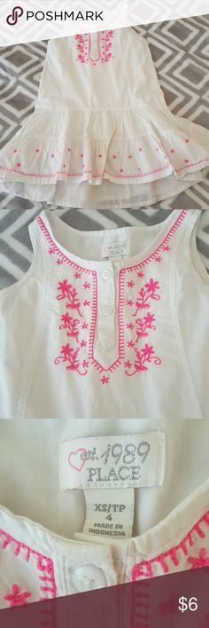 White and pink dress Gently used white cotton dress with bright pink embroidery. Dress is fully lined with cotton underneath. Adorable dress. 2 buttons at neck line but they do not need to be undone to put dress on or off. Wash and dry. Slight staining at neck line but is hardly noticeable . This was one of my daughters favorite dresses. Children's Place Dresses Casual
