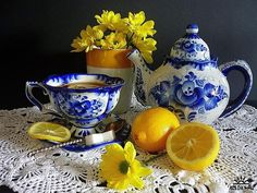 Blue and White Teapot and Tea Cup w/ Yellow Flowers and Lemons