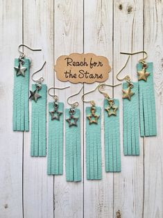 Genuine leather earrings, rectangle shape, fringe at the bottom, star charm in gold or silver finish, Reach for the Stars by ShorelineGraphixInc on Etsy https://www.etsy.com/listing/589800732/genuine-leather-earrings-rectangle-shape