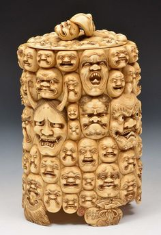 A Japanese carved ivory vase and cover Meiji perio