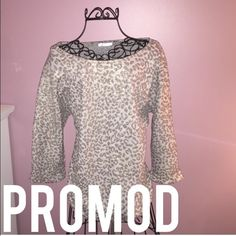 Promod Sweater Like Leopard Print Top Top is meant to be a little oversized. It is from Promod. It has a leopard print and little specs of gold in it. The sleeves are 3/4 length and it is in beautiful condition! Promod Tops Blouses