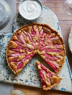 This rhubarb frangipane tart recipe can be made a day ahead, making it an ideal dinner party dessert. Sharp, candy-pink rhubarb is the perfect contrast to the sweet frangipane, and a welcome sight during the winter months