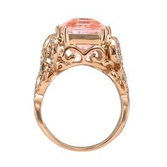 This 7.62 Morganite stone is NOT heat treated and is set in 18k rose gold and accented with .51tw round brilliant diamonds.