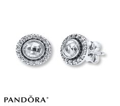 Large faceted clear cubic zirconias encircled with more sparkling cubic zirconias lend classic style to these sterling silver earrings from the PANDORA Spring 2014 collection. The earrings are secured with friction backs. Style # 290553CZ.
