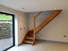 Our customer opted for an oak staircase consisting of open risers. The glass balustrade complements the contemporary look of the property. Bespoke Staircases, Wooden Staircases, Curved Staircase, Staircase Design, Glass Stairs, Metal Stairs, Wooden Stairs, Stair Builder