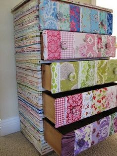 I have thought of doing this but I need to find another dresser!!!!!!  This would be great for my sewing room :)