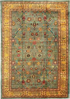 Antique Agra Carpet from the Nazmiyal Collection. Indian carpets developed under the auspices of the Mughal emperor Akbar, in the 16th C. They use the persian knot and very dense count. The delicate palette and open field set it apart from persian carpets.