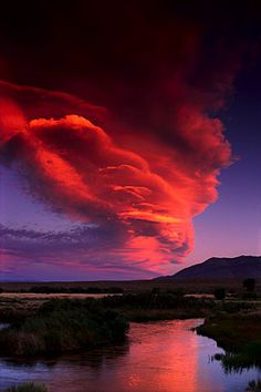 Lenticular cloud over the Owens River, Eastern Sierra (California, 1991) - Galen Rowell. Amazing landscape photographer.
