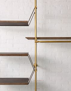 The Collector's Shelving System options include: Hanging Strap Shelf Support, Posting Strap Shelf Support, Knife Edge Detail, LED Light Bar, and completely adjustable Brass Shelving Supports. Brass Shelving, Modern Shelving, Minimalist Shelving, Retail Shelving, Oak Shelves, Wine Shelves, Modular Shelving, Wood Shelf, Adjustable Shelving