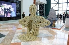 Architects and designers construction amazing 3D sculptures out of food cans for the 2014 Canstruction competition.