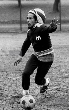 .Bob Marley playing soccer