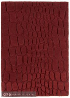 Croc Rugs are handmade in India and feature a plain red colour with a contemporary, sculptured crocodile skin effect.