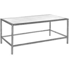 A little edge paired with function. This hand cast pyramid stud coffee table will rock your world.    Finish: Antique Silver Leaf